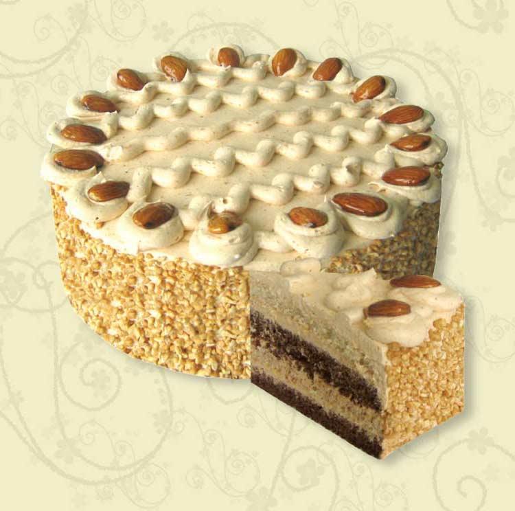 Торт оформлен дутым рисом и миндалем.  420ккал/100г.